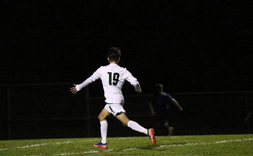 Junior Edwen Diaz runs down the field, awaiting a pass on Oct 24.