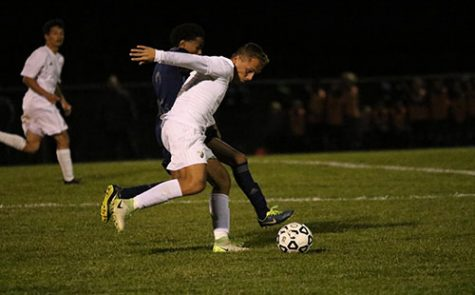 Senior Ethan Rodriguez tries to shake off the player from Olathe West High School at the game on Oct. 24