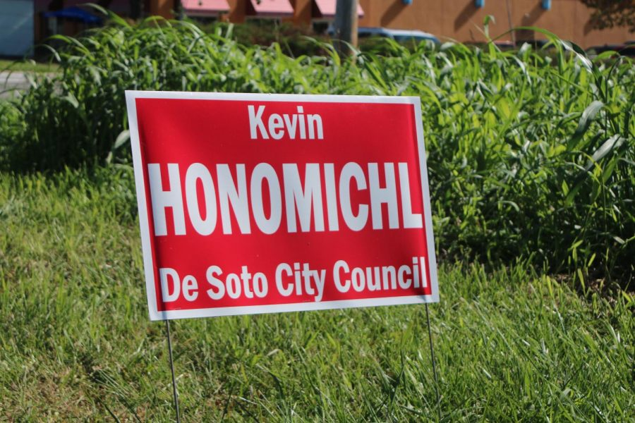 A sign for City Councilman at-large candidate Kevin Honomichl is planted near DHS property.