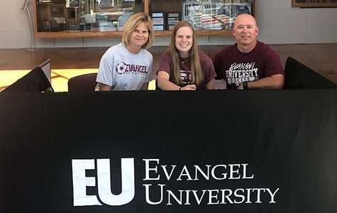 Senior McKenna Webber signs to play soccer at Evangel University with her parents, Jon and Cathy Webber, on Sept. 30.