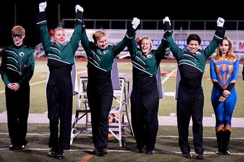 DHS drum majors after being announced grand champions on Oct. 11