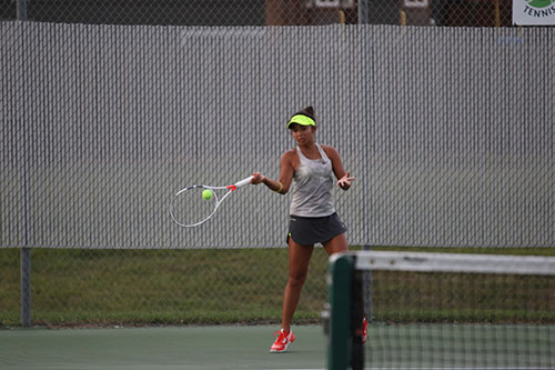 Issa Sullivan forehands the ball during tennis match on Sept. 15