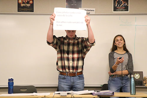 Senior Zach Yarborough holds up a foreign language question at Scholars Bowl practice on Oct. 24. Photo by Johnny Meehan.