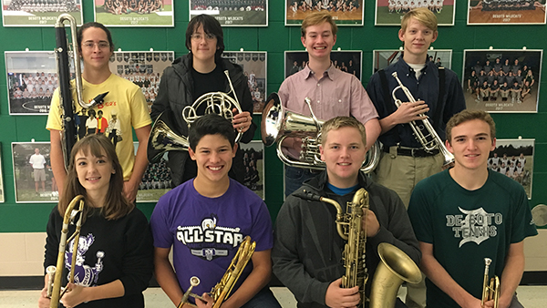 Members of the NEKMEA District Honor Band pose with their instruments.