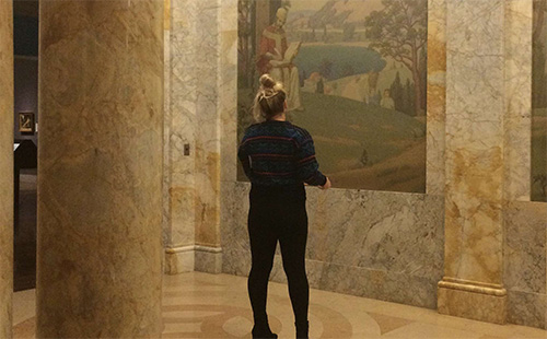 Senior Allison Coy looks at a wall mural on the art field trip to the Nelson-Akins Museum of Art.