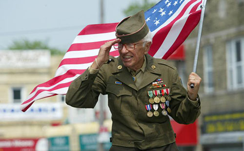 American soldier getting honored at an event.