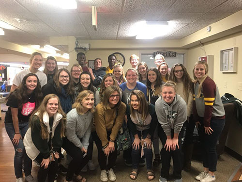 NHS students pose for the camera after a day of bingo at the De Soto Nursing Home on Nov. 18.
