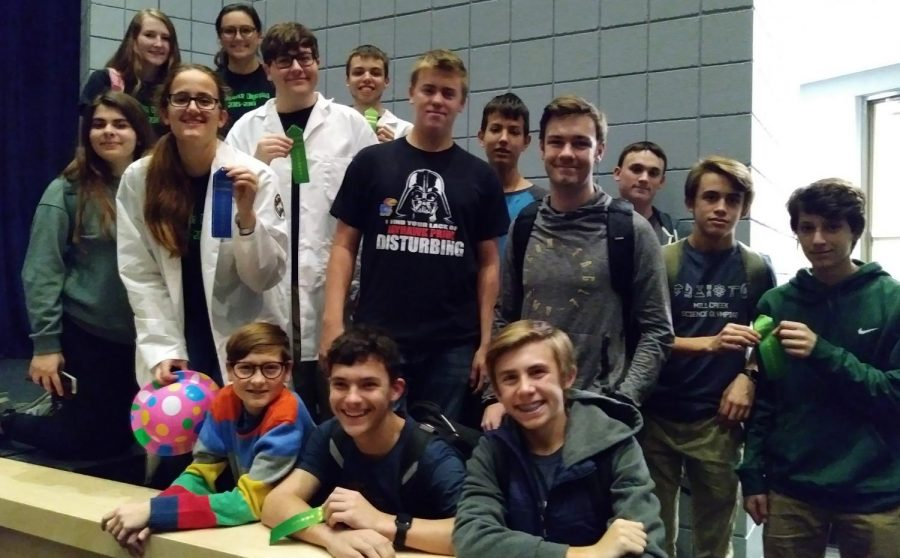 The De Soto Science Olympiad team gathers by the Olathe North stage at the