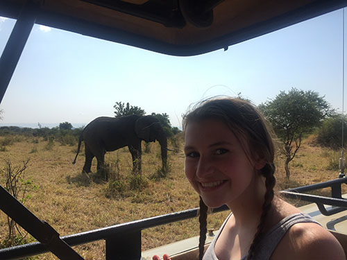 Sophomore Ashlen Boresow poses with an elephant during a safari expedition in Africa.
