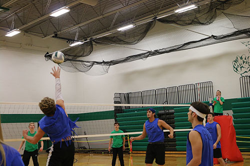 Senior Bryce Mohl sets the ball at the Power Volleyball game on Nov 29.