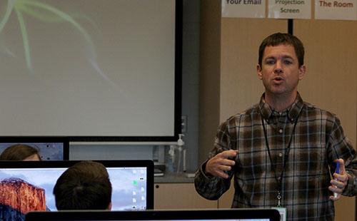 Ben Stamey directs his Web Page Design class in an activity on Dec. 13.