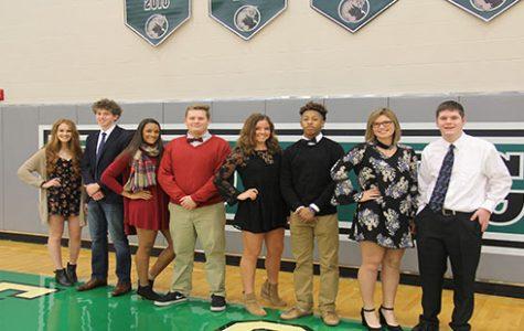 Senior candidates Mackenzie Clark, Jared Baruth, Haley Dalrymple, Kyle P. Bell, Kira Horn, Exavier Jackson, Josie Bedford and Alex Webber pose in the DHS gym.