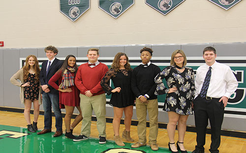 Senior candidates Mackenzie Clark, Jared Baruth, Haley Dalrymple, Kyle P. Bell, Kira Horn, Exavier Jackson, Josie Bedford and Alex Webber pose in the DHS gym.