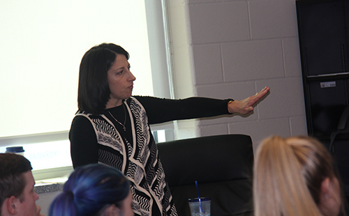 Counselor Crissy Johns explains to a group of De Soto High School students some of the new classes that will be available for the 2017-18 school year on Jan. 24