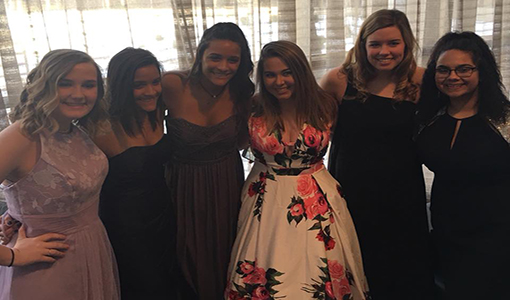 Models junior Lizzy Arnold, seniors Kenize and Haley Dalrymple, junior Caroline Whipple and seniors Payton Faddis and Mireya Edwards Nino pose after the show.