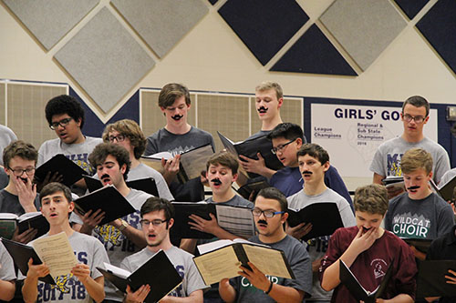 Students perform with fake mustaches at the USD 232 Tenor/Bass Festival on Jan 8. Photo by Rylee Wilson.