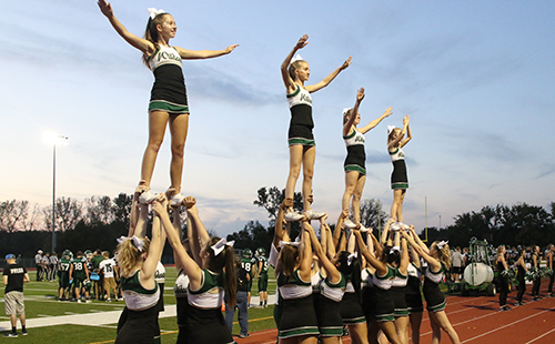 DHS cheerleaders fly high at home Football game.