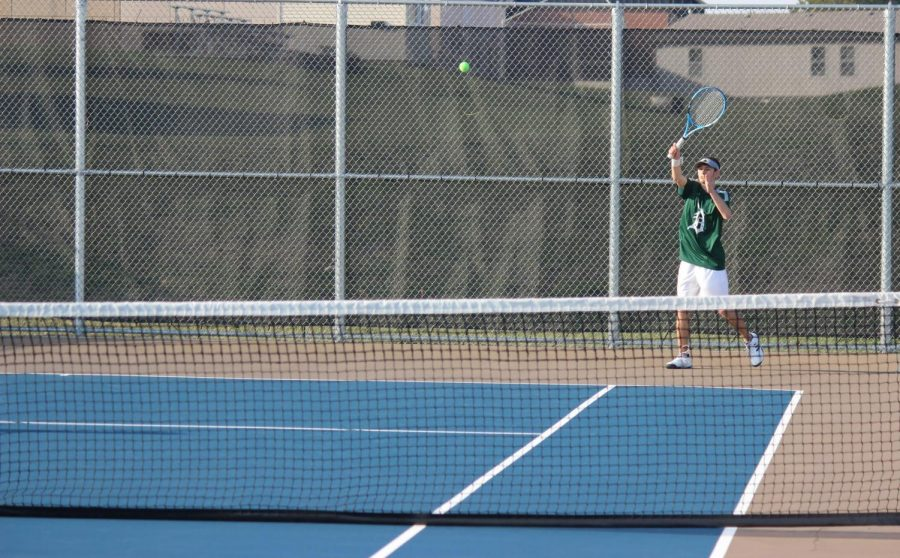 Senior Tait Theel returns a shot in a doubles match against opponents from Spring Hill on April 5.