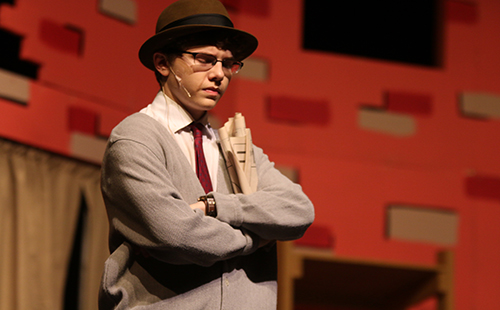 Junior Connor Young plays an irritated Mr. Mushnik in the De Soto High School spring musical Little Shop of Horrors.