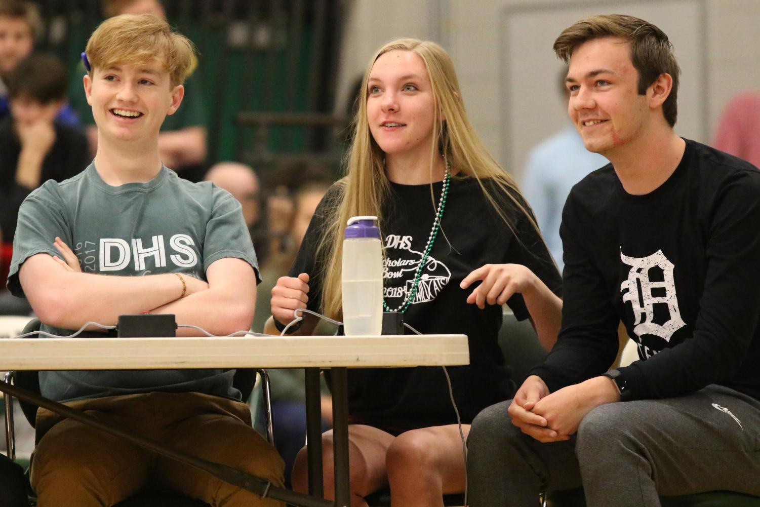 Scholars+Bowl+members%2C+seniors+Zach+Yarbrough+and+Abigal+Stutzman+and+junior+Cody+Murphy%2C+participate+in+a+game+against+teachers+in+honor+of+winning+State+earlier+this+year.