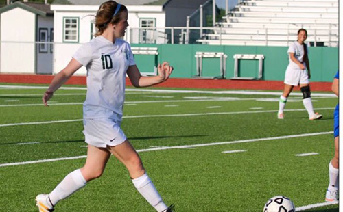 Senior defender Alex Schemmel dribbles the ball up the field at a home game during the 2017 season.