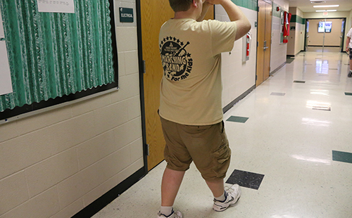 Sophomore Connor Cravens practices his roll steps in preparation for the Masonic Marching Band on May 22.