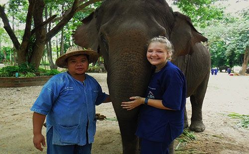 Grieshaber poses with an elephant and a local