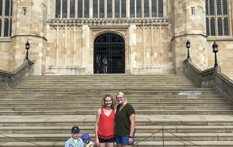 Senior Kasey Seaba standing in front of the Windsor Castle Cathedral in Berkshire, England, with the family she stayed with over the summer in Andover, England.