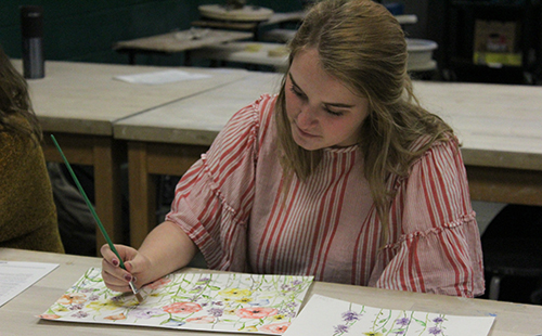 Senior Madeline Merckling works on her art in AP Studio Art on Aug. 30, 2018. You can find more of her artwork at mjmerckling.com or on her business Instagram: @mjmerckling