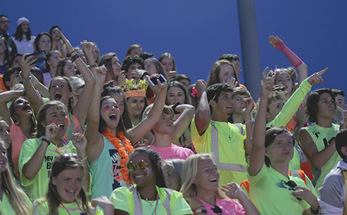 Students decked out in neon apparel celebrate during a football game in the 2017 season. Pep Club will be supporting similar school events in the 2018-19 school year.