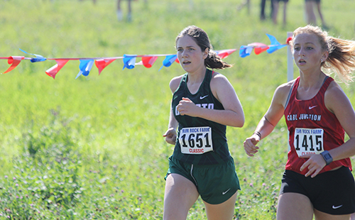 Senior Alyssa Perry pushes through the five kilometer girls' cross country race at Rim Rock Farm on Sept. 23, 2017.