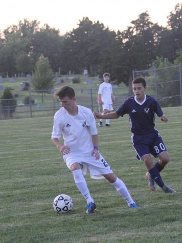 Senior Carson Brier dribbles the ball at a home game in 2017.