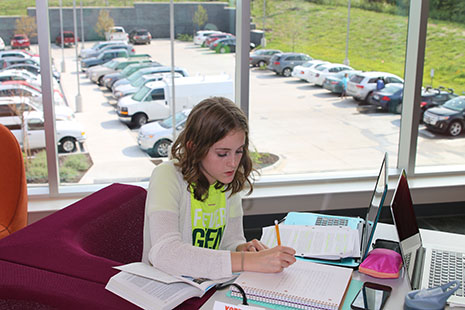 Junior Mason Johannes works on homework at the Monticello Library on Aug. 23.