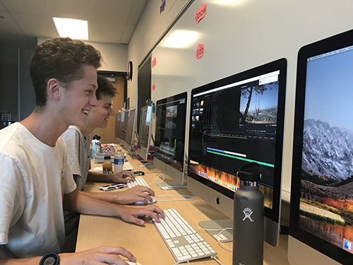 Juniors Chase Culver and Colin Campbell edit their videos for their upcoming project in Video Production on Aug. 24.