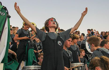 Sophomore Connor McCall celebrates in the band section at a football game during the 2018 season.
