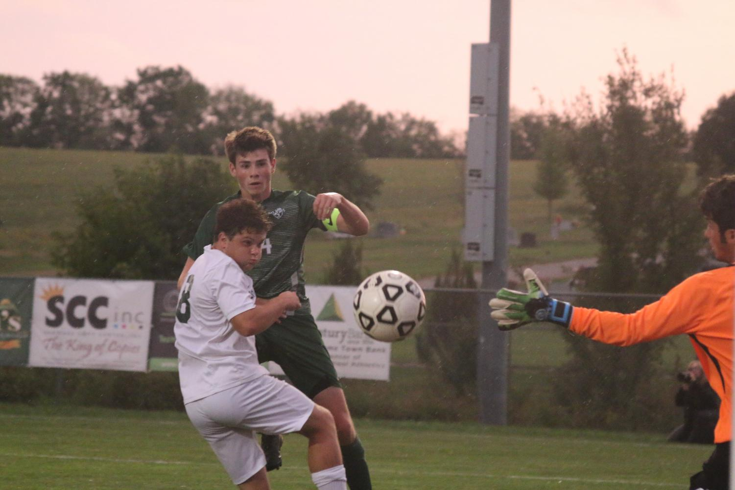 Senior+defender+Sean+Eggers+places+a+header+past+the+Basehor-Linwood+goalie+to+strike+first+in+a+4-0+win+for+the+Wildcats+on+Sept.+25.
