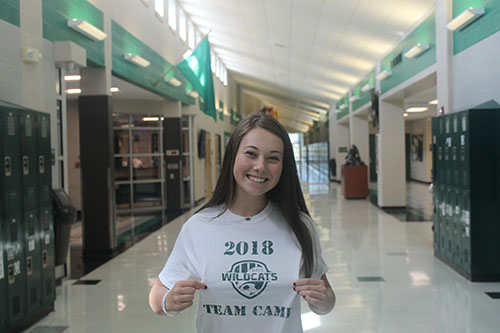 Sophomore transfer student Ella Boxx shows off her new DHS shirt in the main hallway on September 25.