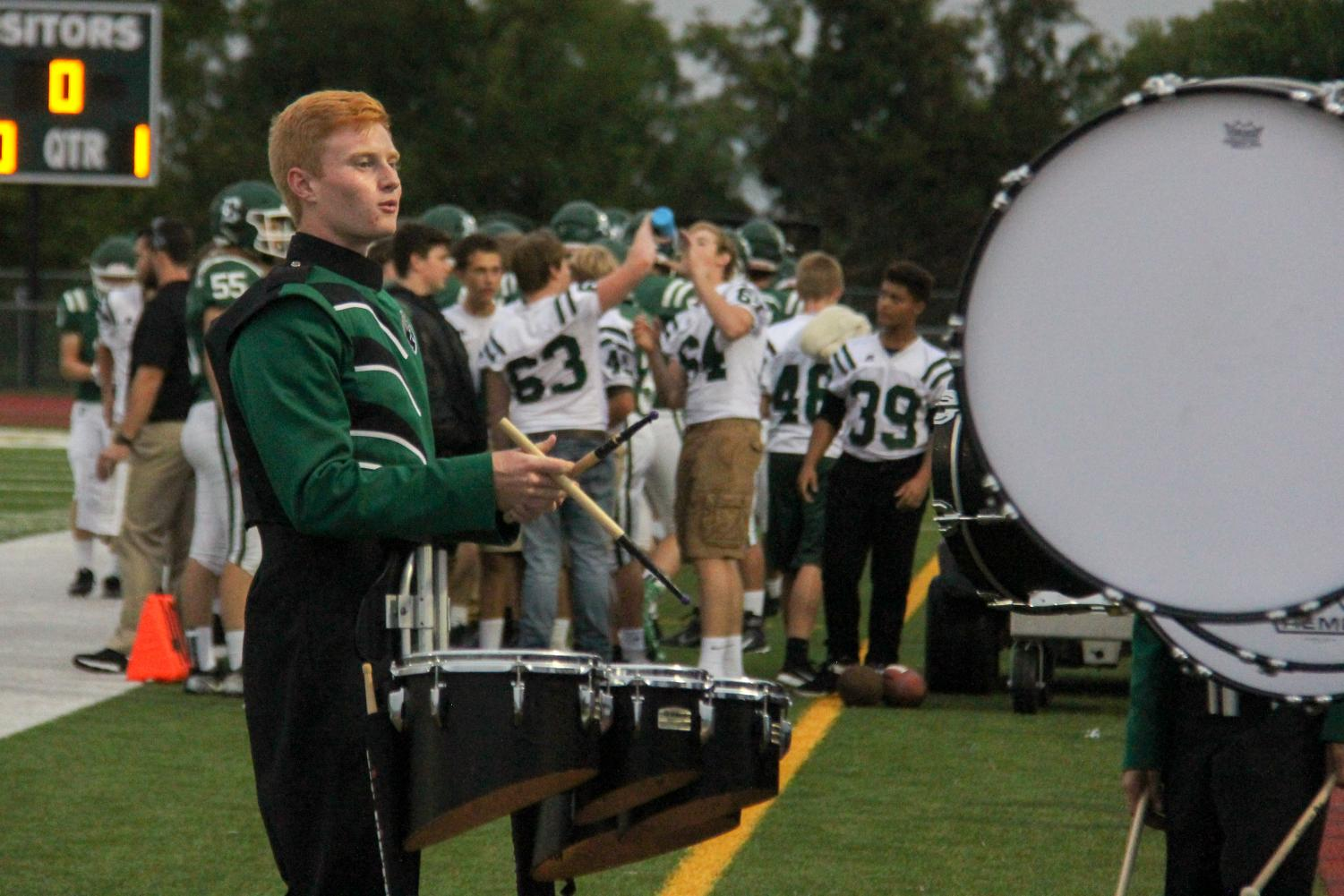 Junior Cody Adams plays marching quads in the home football game on September 7.