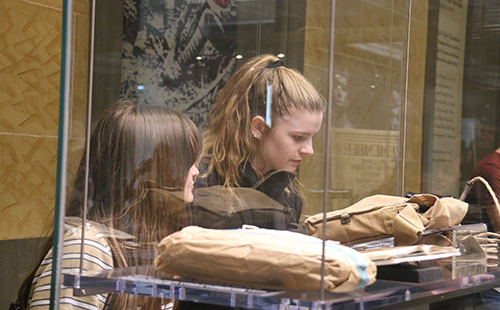 Juniors Camryn Robbinson and Hayley Moss carefully view different artifacts at the National World War I Museum on Oct. 3.