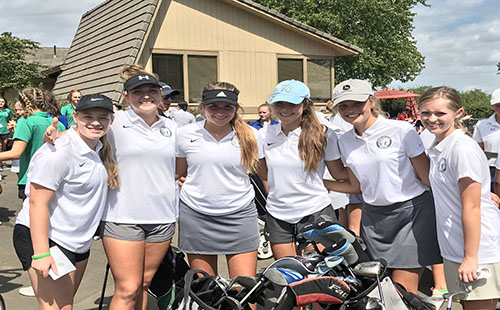 The girls' varsity golf team poses for a photo at the Overland Park Golf Course on Sept. 9.