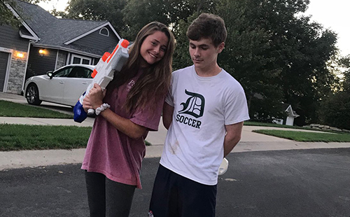 Seniors Loren Hinkle and Daniel Apple pose for a picture after Hinkle 'assassinated' Apple with a water gun on Sept. 26.
