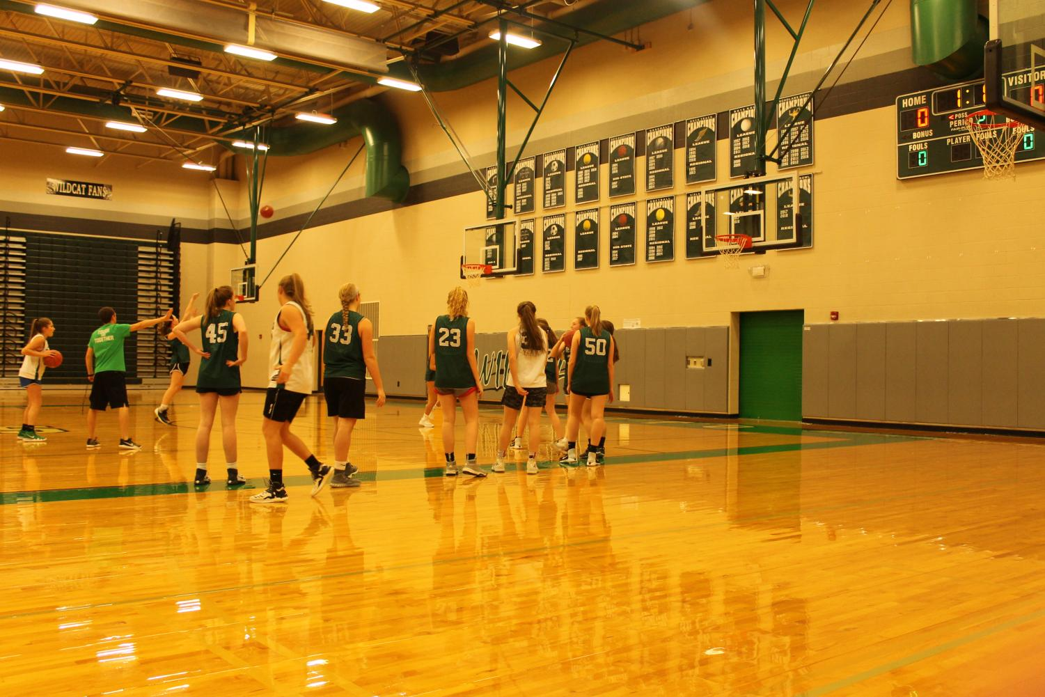 The girls basketball team practicing in the main gym on November 27th.