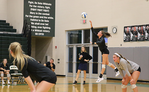 Senior Loren Hinkle serves the ball over the net during the substate game versus Topeka Seman on Oct. 20.
