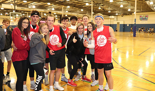 A group of junior supporters pose with the team for a picture after the Spice Boys game on Nov. 13 at Okun Fieldhouse.