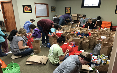 National Honors Society students help package food for families in need at the De Soto Food Pantry on Nov. 16 and 17.