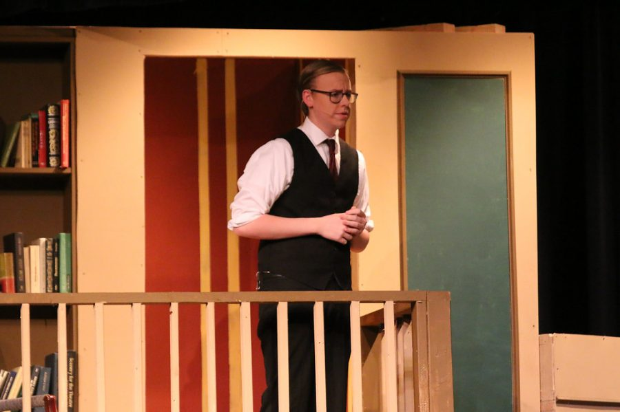 Senior Trace Harre plays Rogers, the butler, in the play And Then There Were None on March 1, 2018.