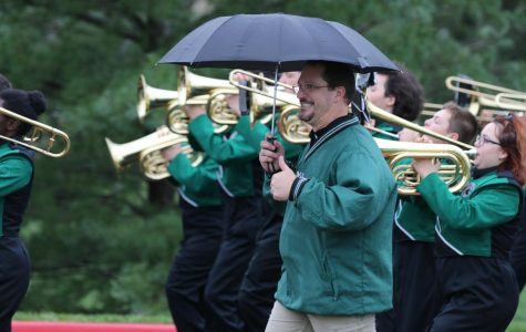 De Soto band director Matt Bradford walks alongside the DHS Marching Wildcats on Sept 7, 2018.