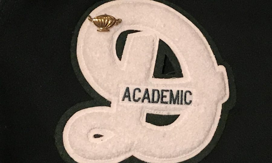 "Each of the 258 recipients of the academic letter were given this cursive ""D"" as well as a pin on Jan. 8 to commemorate their accomplishment."