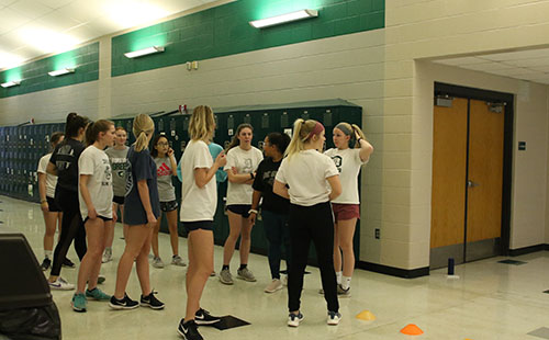 The DHS girls' soccer team prepares to warm up at their conditioning session after school on Jan 15.