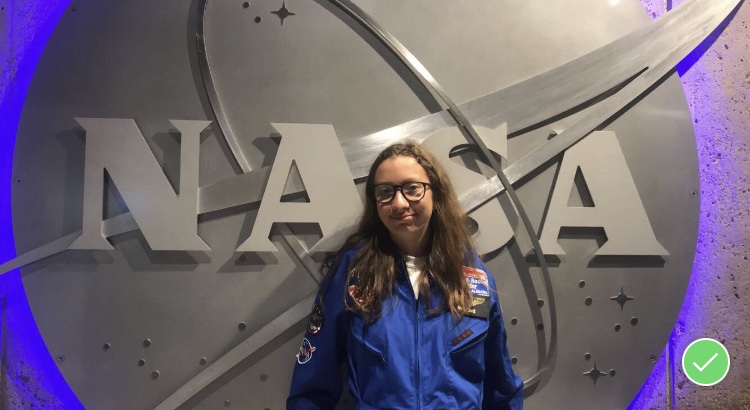 Sophomore Isabel Haake poses in front of the NASA logo while attending space camp in Huntsville, Alabama, in 2018.